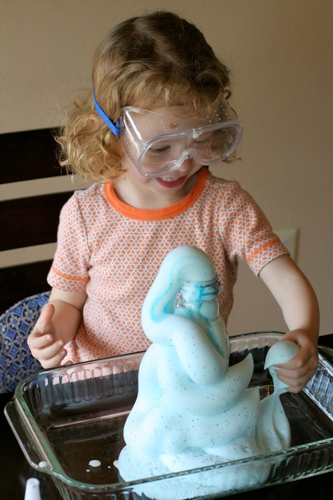 young student with a volcano science project